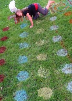 Homemade Outdoor Twister Game by sassystyleredesign.blogspot: So much fun and so easy with spray paint (Rustoleum 2x coverage paint) and a homemade cardboard stencil! Make 4 columns of 6 circles, each column a different color. Make slips of paper with  directions (Head, Rt. Foot, Rt. Hand, Left Foot, Left Hand) and color slips in each of the four colors. Place each set of strips in a jar. The player draws one slip out of each jar.  #Twister #DIY #sassystyleredesign_blogspot
