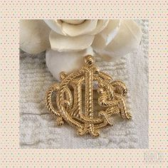 """Authentic Vintage Christian Dior Logo Brooch Measures about 1 1/2"""" x 1 1/2"""".  C Dior logo script in gold tone.  Signed Chr Dior.  In excellent vintage condition.  Clasp and pin in working order.  No trades or PayPal. Dior Jewelry Brooches"""