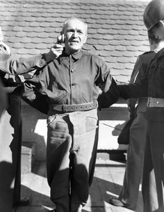 concentration camp guards - Nazi war criminal Emil Hoffman, convicted at the Nuremberg trials, makes his last statement prior to execution by hanging in 1946