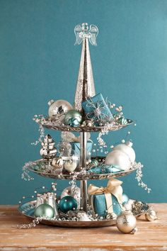 Magnificent Blue And Silver Holiday Decor Ideas, Chandeliers enhance the pure light in a place. Beautiful and inexpensive Christmas centerpieces is an easy means to earn holiday table appear gorgeous. Silver Christmas Decorations, Christmas Centerpieces, Christmas Ornaments, Coastal Christmas, White Christmas, Christmas Holidays, Turquoise Christmas, Deco Table Noel, Blue And Silver