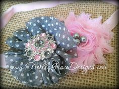 """Light Pink & Grey Polka Dot Flower Headband. A beautiful combo of grey and light pink. Both flowers are made from chiffon. Accented by a stunning grey & pink center and small grey pearls. Shown here on a light pink 3/8"""" satin elastic band. Each flower is approximately 2.5"""" across. by Noelle Grace Designs"""