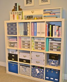 Great use of multiple, colorful storage containers that mesh well with like colors, and are very practical for different sized office supplies that need to be stored.