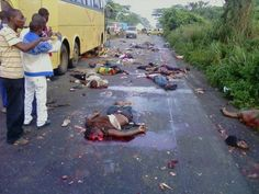 Helpless Nigerians run over by a trailer after they lay down on the ground on the orders of armed robbers.