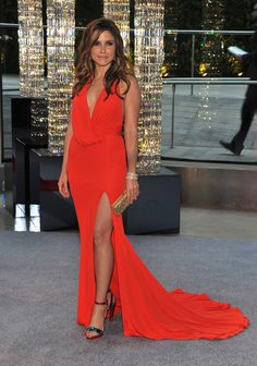 Sophia Bush attended the CDFA Awards in this sensational, tangerine, David Meister draped gown with a sexy thigh-high slit.    The fashion forward star accessorized with colorful Christian Louboutin heels, a David Swarovski clutch and glittering Lorraine Schwartz jewels.    Lovely beach waves and sun-kissed makeup enhanced her relaxed and effortless summer look.