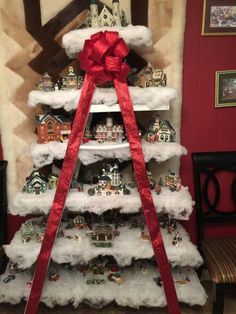 Fun way to display your Christmas village using a wooden ladder !