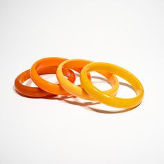 Set of four bakelite bracelets // 1940s, USA // orange and yellow bakelite // stack of vintage bangless on Etsy, $325.00