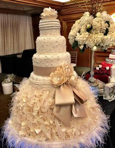 I would not choose same decor but I like how the set up makes the cake look bigger. Good for a small wedding.
