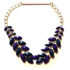 Statement Necklace NWT Gold tone chain and gem stones are on this necklace . The stones  2 colors , are purple and a dark shade of navy or black it's hard to tell which shade it is . New with tag. Jewelry Necklaces