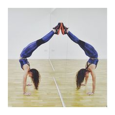 Awesome yoga pose and great use of mirrors and symmetry