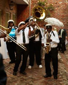Smitty Dee's Brass Band, a traditional New Orleans second-line band, led wedding guests through the streets to the reception venue.