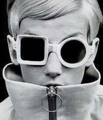 Twiggy in geometric shaped glasses
