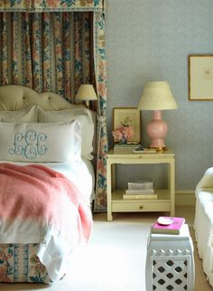 The master-bedroom walls are upholstered in Bennison's Kasumi pattern. The curtain and bed hanging fabric are also Bennison. |  Ashley Whittaker