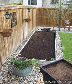 Pebbles/gravel border around raised planter