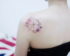 Floral compass tattoo on back shoulder by Tattooist Banul