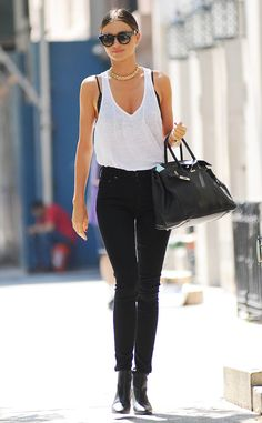 Model Strut from Celebrity Street Style  It doesn't matter whether she's on the runway or the sidewalk—Miranda Kerr knows how to strut her stuff. The supermodel shows off her svelte figure wearing a loose white tank and black skinny jeans in NYC.