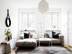 Sectional sofa in a small apartment with throw pillows and bright light