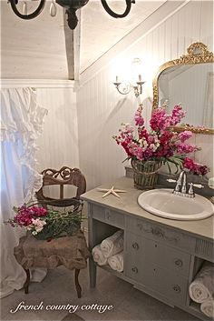 bathroom makeover remodel design decorating french cottage sconces chandelier bead board antique mirror plank ceiling sideboard vanity sink ruffled drapes