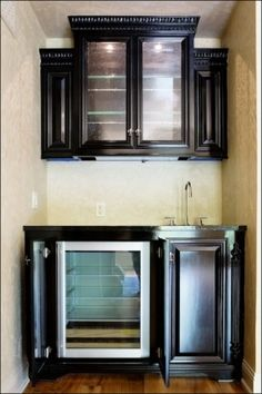 This is called a morning kitchen. It is in made for your bedroom. A lot of times people will use it to set breakfast on the countertop or people will make coffee while getting ready in his or her room. The undercounter refrigerator provides nice storage.