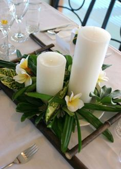 Tropical wedding centerpiece with white pillar candles - beach Ideas and inspirations - summer beach theme.