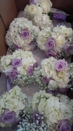 Purple and white bridesmaid bouquets by Royal room