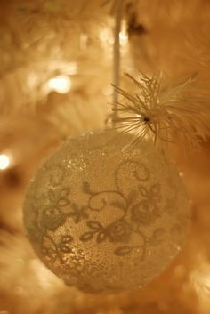 Cute idea...lace over a glass ornament then clear glass glitter or even Epson salts