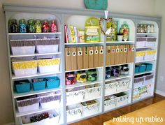 very organized crafting area, 4 cheap bookcases with molding added