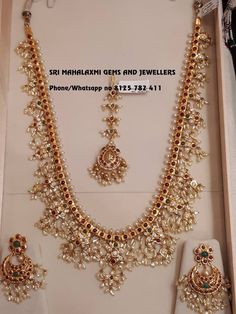 Light weight Guttapusal haaram set with ear rings Tika. Beautiful long haaram with guttapusalu hangigns. Long haaram with matching chaandbalies. 04 May 2018 Indian Jewelry Sets, Indian Wedding Jewelry, Bridal Jewelry, India Jewelry, Jewelry Design Earrings, Gold Jewellery Design, Necklace Designs, Gold Jewelry Simple, Silver Jewelry