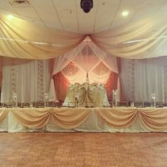 Elegant stage setting and sweetheart table at summer wedding reception!