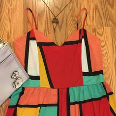 NEW MINI SPAGHETTI STRAP DRESS SZ L  ⛱ SIZE LARGE MINI SPAGHETTI STRAP DRESS! SUPER EASY TO WEAR! GORGEOUS BOLD COLORS WILL MATCH ANY SHOES/PURSE/SHRUG! 96% POLY/4% SPANDEX! ARRIVED WITH A TINT SPOT...SEE PIC #4. I TRIED TO ZOOM IN, so small could not focus. PRICED ACCORDINGLY! VIBRANT RED, LIGHT GREEN, BRIGHT YELLOW, LIGHT ORANGE, WHITE! BLACK BLOCK PATTERN! SUPER SIMPLE, YET CLASSY!  Grace K Dresses Mini