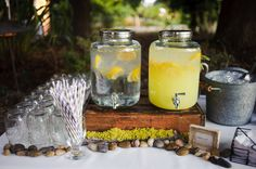 love this display with rocks, moss, galvanized tub of ice, beverage dispensers, mason jar glasses and wood crate.