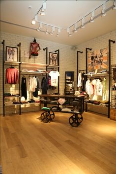 Love the clean look that wall outriggers provide for an apparel store Pepe Jeans, New concept store. Apparel retail store fixtures