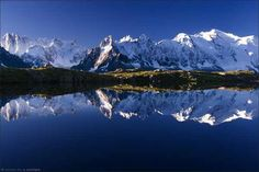 """mountain reflection Mont Blanc or Monte Bianco both meaning """"White Mountain"""", is the highest mountain in the Alps and the European Union"""