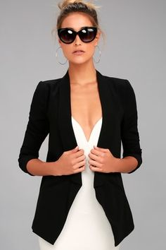 Lulus Miss Punctuality Black Blazer! This woven poly blazer has skinny tuxedo-style lapels that frame an open-front design with a pointed hem. Padded shoulders introduce long sleeves, and faux welted pockets are a welcome detail at front.