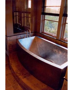 This copper bathtub is curved under the knees so you won't slide down in the tub.  Wow.  Somebody is smart.