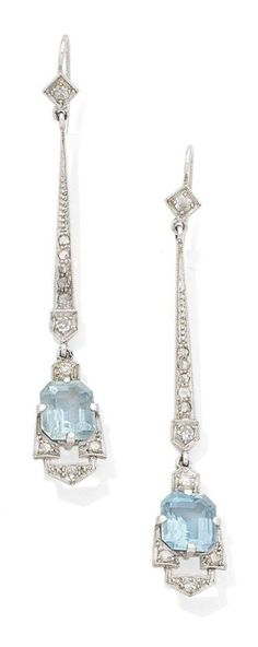 A pair of early Art Deco diamond and aquamarine pendent earrings, circa 1915. Each step-cut aquamarine within an openwork geometric surround, suspended from a tapering surmount, millegrain-set throughout with single and rose-cut diamonds, later post fittings, length 6.0cm. #ArtDeco