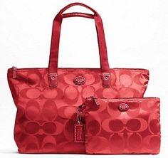 'NWT RED COACH Signature Nylon  Travel Tote Set' is going up for auction at  1pm Sat, Oct 19 with a starting bid of $1.