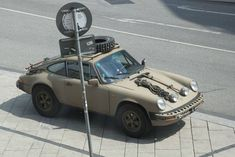 Poor Porsche *sigh* -- but one must do what one must during the Zombie Apocalypse. At least they'll be destroying zombies in style! Porsche 911, Porsche Autos, Porsche Carrera, Lamborghini, Ferrari, Honda Jazz, Offroad, 4x4, Monaco