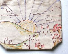 hand-painted canvas tote bag with bunnies and mushrooms.