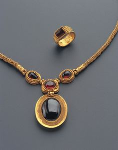 Greek Hellenistic Jewelry Set- Phoenix Ancient Art Some of the items in the Phoenix exhibit include: 'The Emperor Licinius', a small gold leaf bust from the 4e century A.D.; an ancient Greek Hellenistic gold and garnet jewelry set consisting of a necklace and a ring; a mosaic from the 2nd century A.D. and a mysterious marble portrait from Rome.