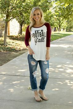 """Show your team spirit with this classic cut """"football y'all"""" tee! Available in two colors, this casual comfy little tee is perfect for your next kick off. Scoop neckline with a white body, black lette"""