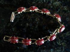 """Darling vintage raised ladybug bracelet with gold tone metal base. Fits a 7"""" wrist."""