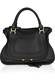 """Enduring pebbled calfskin. Bright, matte golden hardware. Twisted top handles with signature Chloe bow-shaped rings; 6"""" drop. Removable shoulder strap, 17 1/2""""L. Zip top. Front flap pocket with horses"""