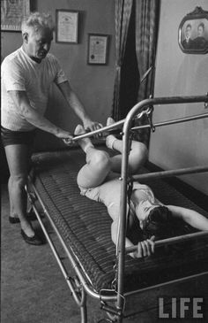 Joseph Pilates with student. Just amazing how equipment has evolved.
