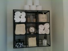 Roll towels up and stack them for a spa-like feel.