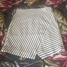 ❤️NWT Anne Taylor Loft skirt❤️ Brand new with tags...a classic piece in any wardrobe. Off White and black stripe skirt comes to a longer inverted V in the front. Side zipper. Material has some stretch to it as well. Size medium. From a pet and smoke free home.NO TRADES LOFT Skirts