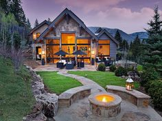 Stone path leads to an outdoor fire pit with breathtaking surroundings.