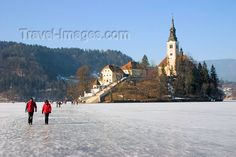 Slovenia - people walking across ice - island church on Lake Bled ...