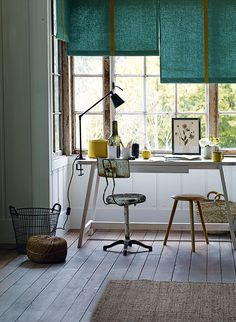An otherwise unused alcove in a bay window, with its view out to the garden, is a delightful location for a study area | Styling Emma Thomas, Ali Brown and Laura Vinden | Photograph Emma Lee | Homes & Gardens | http://www.hglivingbeautifully.com/2016/06/18/the-gardeners-cottage-simple-study-area/