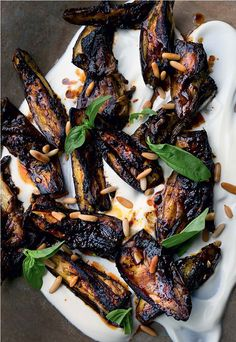 Roasted eggplant with black garlic, pine nuts, and basil from NOPI: The Cookbook by Yotam Ottolenghi and Ramael Scully.