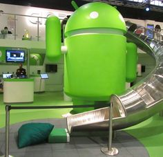 Android trade show booth... love the slide!Wow! I love that android are bold enough to put the fun into their brand.... And are so consistent all the way to their trade stand. Smart!